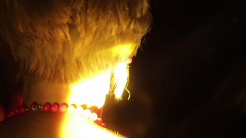 Head of blonde woman dancing at a particularly party in the spotlight 8523 Footage