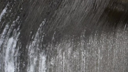 Torrent of water flowing over a waterfall rounded of concrete 20 Footage