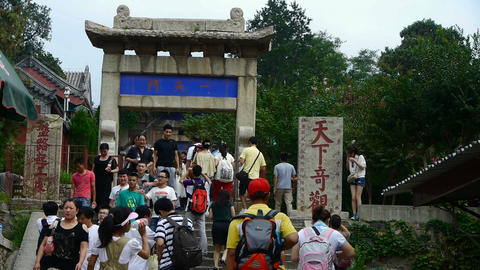 Tourists walking in mountain stone steps,Chinese ancient building arches Footage
