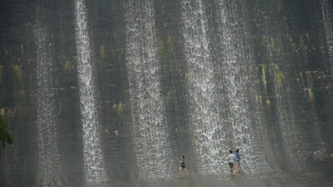 People are playing under dam,Waterfall texture,rainy season Stock Video Footage