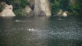 People swimming in lake,relying on Castle Peak Footage