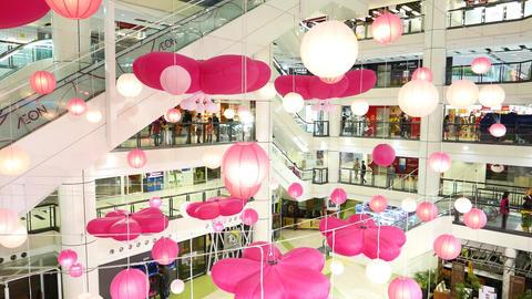 Pink decor hand around white mall atrium hall, parallax shot Footage