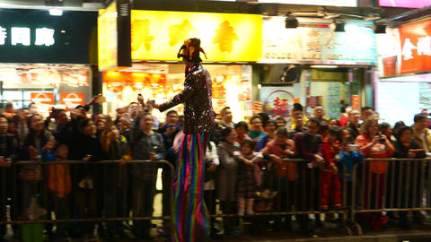 The clown on stilts at the parade passes by spectators Footage