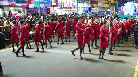 Beautiful stewardesses perform group dance performance, night festival Live Action