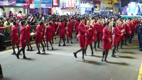 Beautiful stewardesses perform group dance performance, night festival Footage