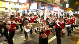 Vivid marching Band on festival parade, night street Footage