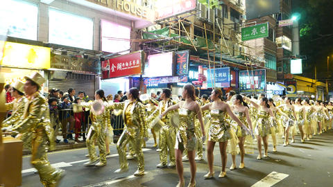 Shiny and zinger dance troop, festival procession on night street Footage