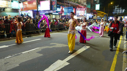 Chinese man dancing belly dance, night parade, New Year celebration Footage