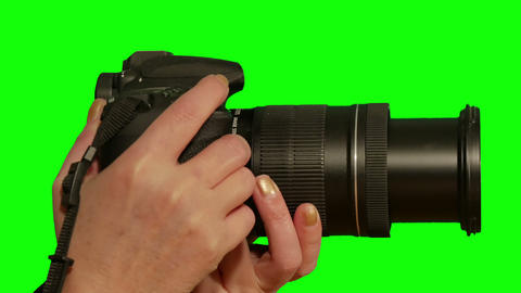 Close-up Camera In The Hands Of The Girl On A Green Screen stock footage