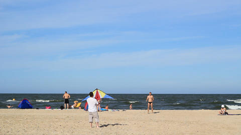 Guys Practicing With A Kite On A Beach 2 stock footage