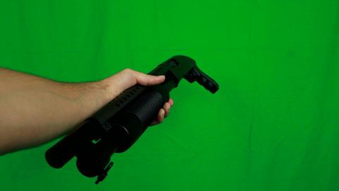 Giving A Shotgun While Holding A Barrel Left Side Live Action