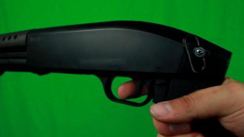 Putting Finger On A Trigger And Holding Shotgun Live Action