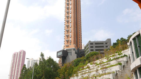 Tall match-like luxury house tower on the mountain side, Hong Kong Footage