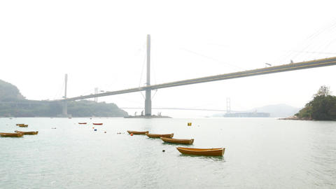 Sea channel, island and long cable-stayed connecting bridge over the water Footage