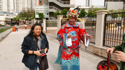 Man in traditional costume, take pictures with tourists, sunny day Footage