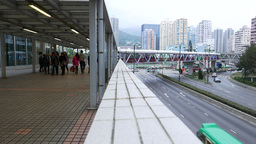 Half by half view pedestrian overpass and street in modern city Footage