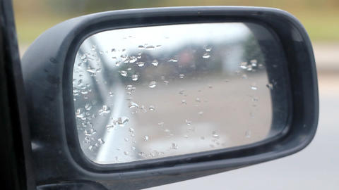 Car Side Mirror View With Water Rain Drops Footage