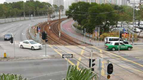 Street junction, car traffic crossing rails of tram, overhead view Footage