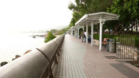 People on seaside promenade, Tuen Mun seafront, public green alley Footage