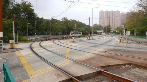 Tram approaching from road turn, Light Rail Transit system, Live Action