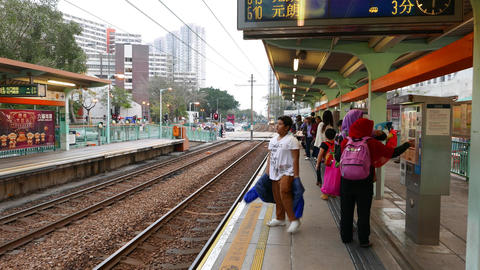 Boy and Muslim girls waiting train on station, Light Rail Transit Footage