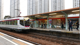 Trolley car arriving at station - open platform, chinese town Footage