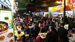 Chinese open-air overcrowded restaurant on night street Footage
