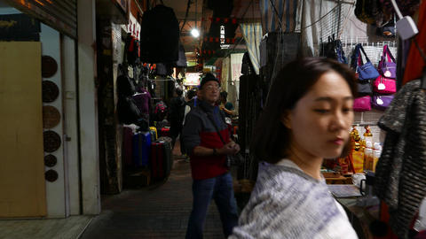 Aisle at night market, narrow passage, POV walking through Footage