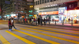 Few people and then young couple crossing night city street, with alert sound Footage