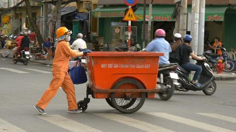 HO CHI MINH / SAIGON, VIETNAM - 2015: Working asia people asian city lifestyle Live Action