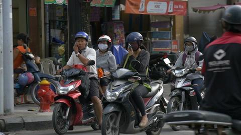 HO CHI MINH / SAIGON, VIETNAM - 2015: Slow motion Vietnamese people streets Footage