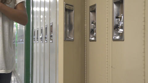 Student using her locker (1 of 2) Live Action