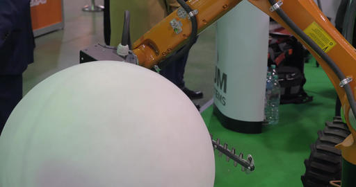 Robot for garden works at Robotics Expo Footage
