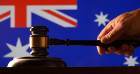 Judge calling order with hammer gavel in australain court with flag background Footage