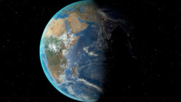 Night to day - rotating Earth. Zoom in on Burundi outlined Animation