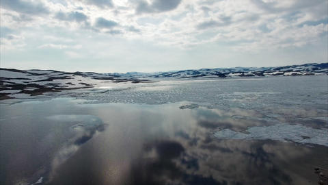 Calm waters of freezing lake in Norway, aerial view Footage