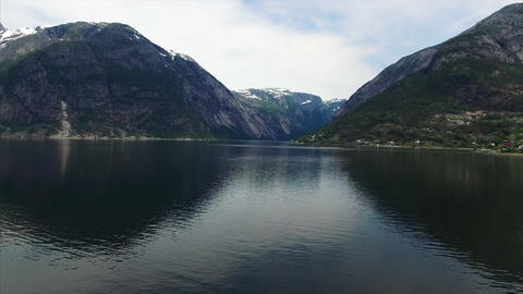 Low above waters of Hardanger fjord in Norway Footage