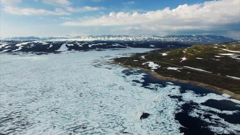 Tourist road passing through mountain pass Hardangervidda in Norway Live Action