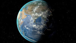 Night to day - rotating Earth. Zoom in on United Arab Emirates outlined Animation