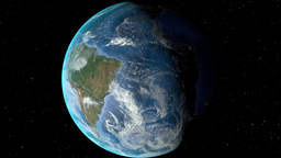 Night to day - rotating Earth. Zoom in on Uruguay outlined Animation