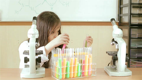 Child scientist mixing test tube chemicals Footage