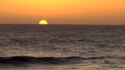 Spain The Canary Islands Gran Canary 032 Maspalomas sunset over water Footage