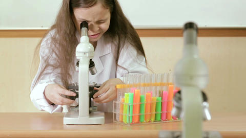 Child scientist looking through microscope Footage