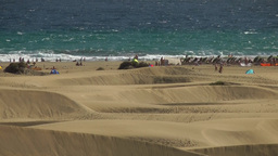 Spain The Canary Islands Gran Canary 022 Maspalomas Beach behind dunes Footage