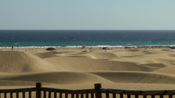 Spain The Canary Islands Gran Canary 021 Maspalomas Beach behind dunes Footage