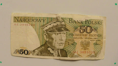 paper money 50 zloty, Poland in 1988 on a white table flipped a hand close up Footage