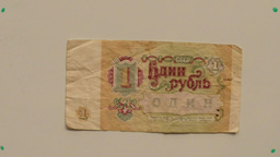 paper money one ruble USSR in 1991 on a white table flipped a hand close up Footage