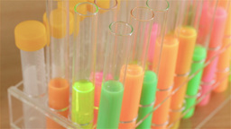 Slider shot across test tubes of bright liquids Footage