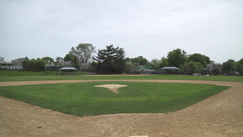 An empty public baseball diamond Footage
