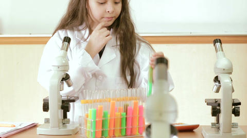 Young scientist checking results of experiment Footage